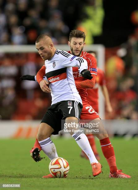 Besiktas' Gokhan Tore and Liverpool's Adam Lallana battle for the ball