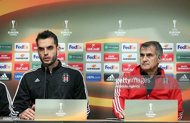 Besiktas' head coach Senol Gunes and defender Luiz Rhodolfo attend a press conference at the BJK Nevzat Demir Facilities in Istanbul Turkey on...