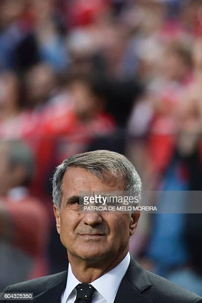 Besiktas' head coach Senol Gunes looks on before the UEFA Champions League football match SL Benfica vs Besiktas JK at the Luz stadium in Lisbon on...