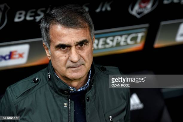 Besiktas' head coach Senol Gunes looks on prior to the UEFA Europa League football match Besiktas vs Hapoel Beersheba on February 23 2017 at the...