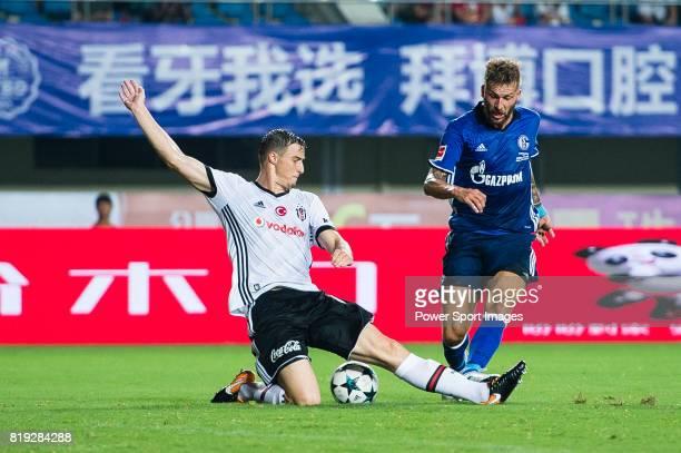 Besiktas Istambul Defender Matej Mitrovic trips up with FC Schalke Forward Guido Burgstaller during the Friendly Football Matches Summer 2017 between...
