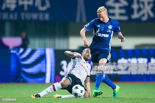 Besiktas Istambul Forward Cenk Tosun trips up with FC Schalke Midfielder Luke Hemmerich during the Friendly Football Matches Summer 2017 between FC...