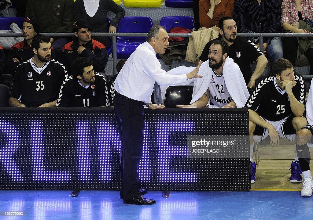 Besiktas JK Istanbul's Turkish coach Erman Kunter (L) speaks to Besiktas JK Istanbul's Croatian centre Damir Markota during the Euroleague basketball match FC Barcelona Regal vs Besiktas JK Istanbul at the Palau Blaugrana sportshall in Barcelona on March 15, 2013.