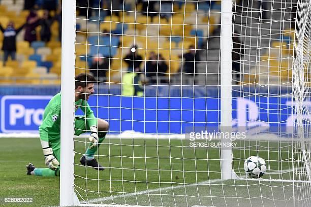 Besiktas JK's Goalkeeper Julien Fabri reacts after loosing a penalty kick during the Champions League football match between FC Dynamo and Besiktas...
