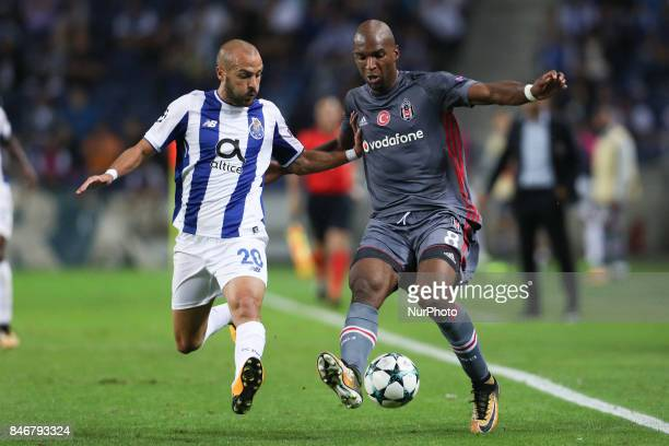 Besiktas' midfielder Atiba Hutchinson in action with Porto's Portuguese midfielder Andre Andre during the FC Porto v Besiktas UEFA Champions League...