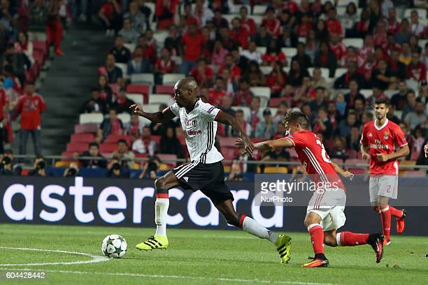 Besiktas' midfielder Atiba Hutchinson vies with Benfica's forward Franco Cervi during the UEFA Champions League Group B football match between SL...