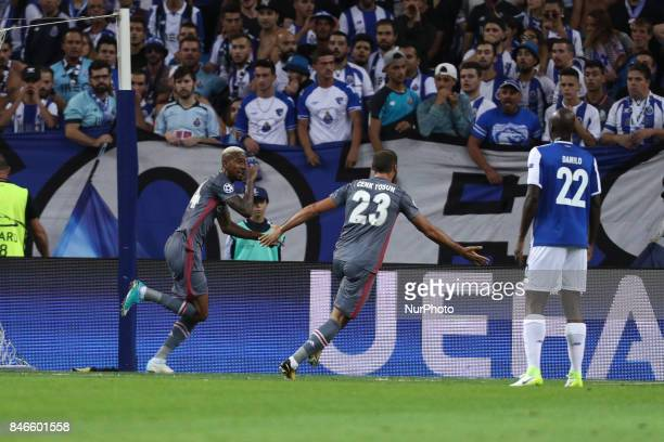 Besiktas' midfielder Talisca celebrates after scoring a goal during the FC Porto v Besiktas UEFA Champions League Group G round one match at Dragao...