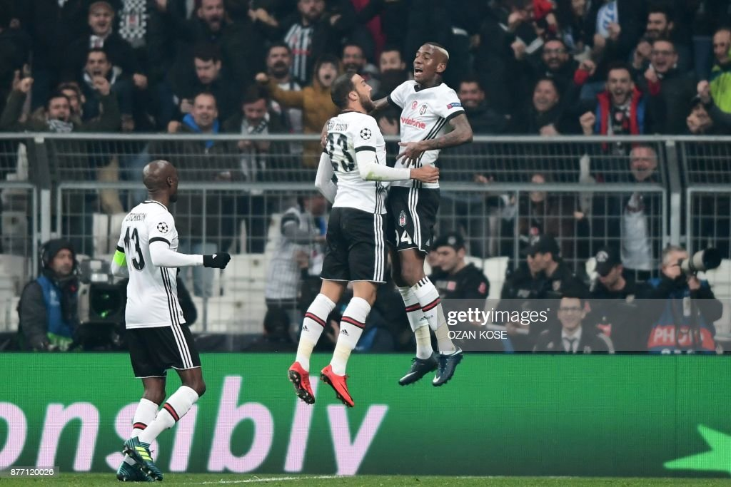 Besiktas' midfielder Talisca (R) celebrates with teammates after scoring a goal during the UEFA Champions League Group G football match between Besiktas JK and FC Porto on November 21, 2017 at the Vodafone Park in Istanbul. /