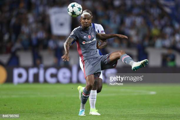 Besiktas' midfielder Talisca vies with Porto's Portuguese midfielder Danilo Pereira during the FC Porto v Besiktas UEFA Champions League Group G...