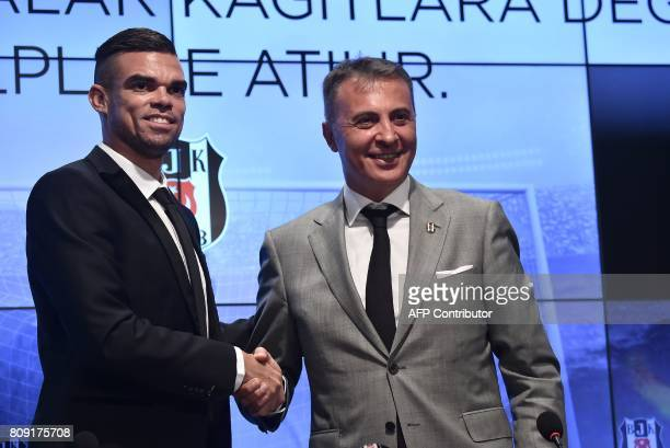 Besiktas' new Portuguese defender Pepe and Besiktas' President Fikret Orman shake hands during Pepe's signing ceremony with the club on July 5 at the...