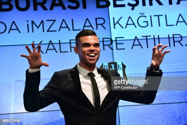 Besiktas' new Portuguese defender Pepe gestures to mimic an eagle during his signing ceremoby with the club on July 5 2017 at Vodafone Park stadium...
