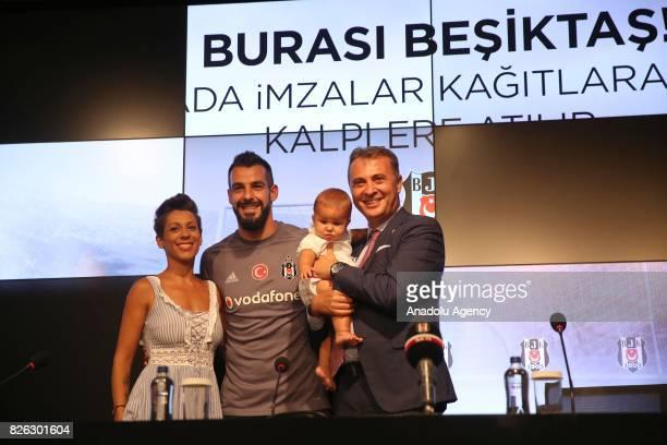 Besiktas' new transfer Alvaro Negredo Sanchez attends a press conference with his baby his wife Amparo Moreno and Besiktas' President Fikret Orman...