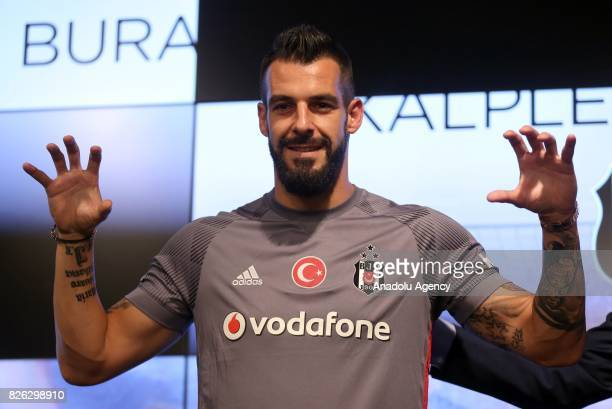 Besiktas' new transfer Alvaro Negredo Sanchez poses for a photo during a press conference after the signing ceremony at Vodafone Park in Istanbul...