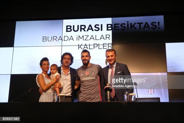 Besiktas' new transfer Alvaro Negredo Sanchez poses for a photo with his baby his wife Amparo Moreno and Besiktas' President Fikret Orman during a...