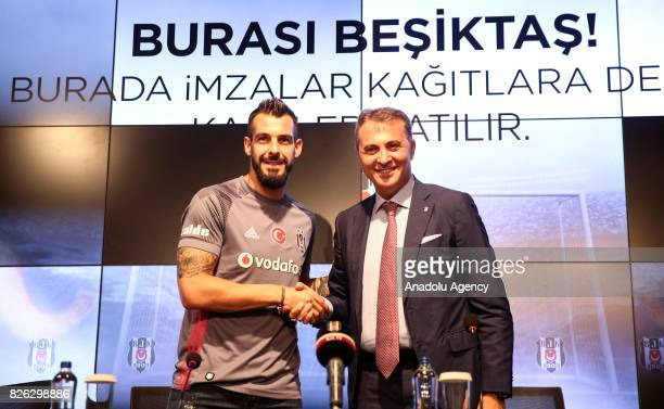 Besiktas' new transfer Alvaro Negredo Sanchez poses with Besiktas' President Fikret Orman during a press conference after the signing ceremony at...