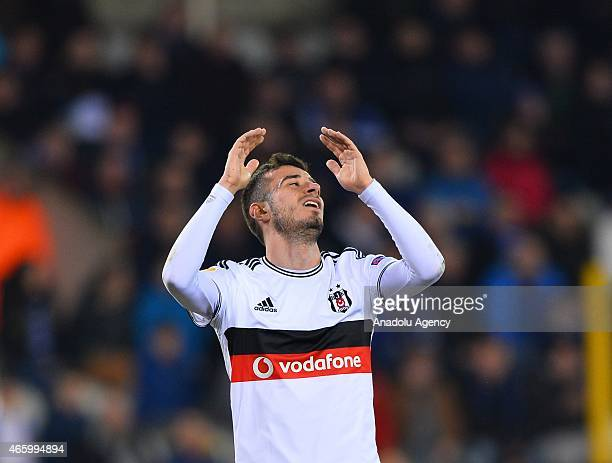 Besiktas' Oguzhan Ozyakup reacts at the end of the UEFA Europa League Round of 16 First leg match between Club Brugge and Besiktas at Jan Breydel...