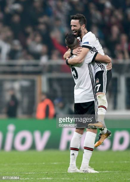 Besiktas' Pepe and Gokhan Gonul celebrate at the end of the UEFA Champions League Group G football match between Besiktas JK and FC Porto on November...