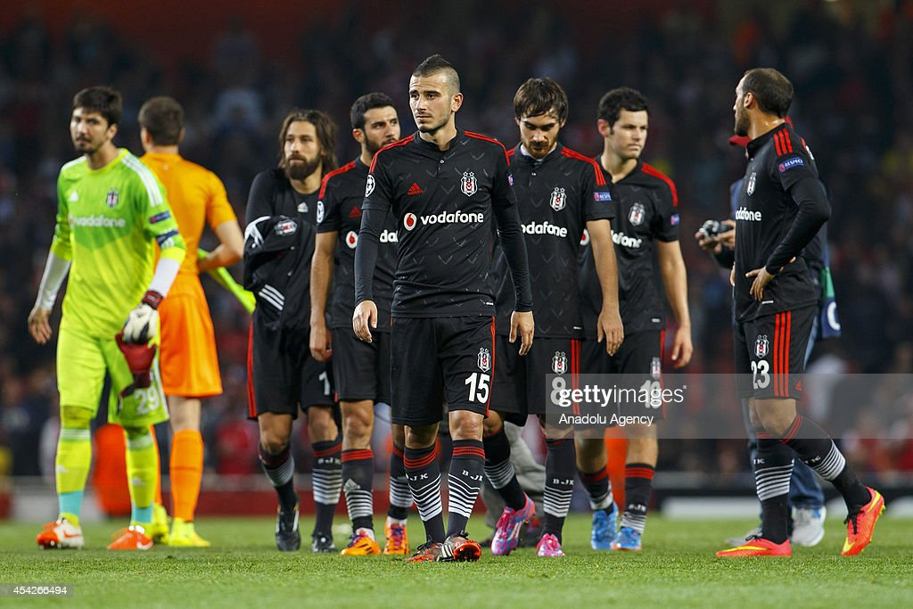Besiktas' players are sad after the UEFA Champions League play-off second leg match between Arsenal and Besiktas at Emirates Stadium on August 27, 2014 in London, England.