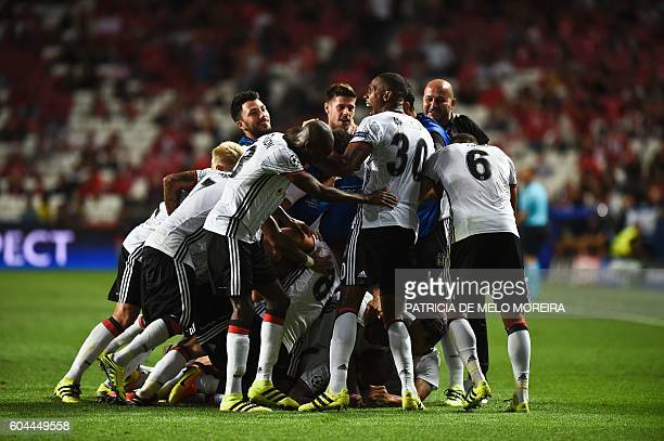 Besiktas' players celebrate a goal during the UEFA Champions League football match SL Benfica vs Besiktas JK at the Luz stadium in Lisbon on...