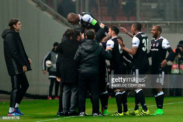 Besiktas' players celebrate a goal during the UEFA Europa League round of 16 first leg football match between Olympiakos Piraeus and Besiktas in...