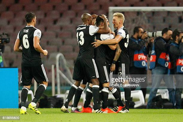 Besiktas' players celebrate after a goal by Besiktas' defender from Brazil Adriano during the UEFA Champions League football match SSC Napoli vs...