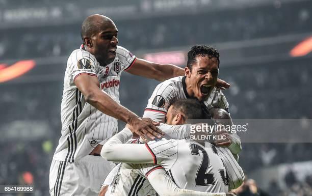 TOPSHOT Besiktas' players celebrate after scoring a goal during their UEFA Europa League round of 16 second leg football match between Besiktas JK...