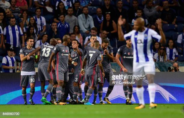 Besiktas' players celebrate after scoring during the UEFA Champions League football match FC Porto vs Beskitas JK at the Dragao stadium in Porto on...