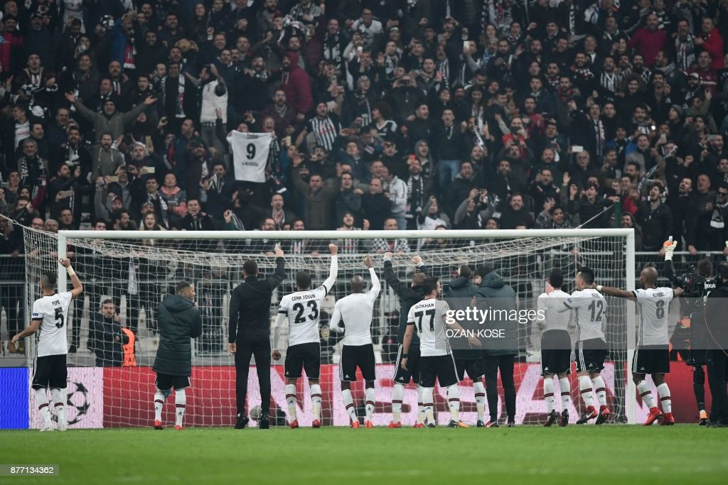 Besiktas' players celebrate at the end of the UEFA Champions League Group G football match between Besiktas JK and FC Porto on November 21, 2017 at the Vodafone Park in Istanbul. Turkish champions Besiktas reached the Champions League last 16 for the first time in 31 years, as a 1-1 draw with Porto in Istanbul wrapped up top spot in Group G. /