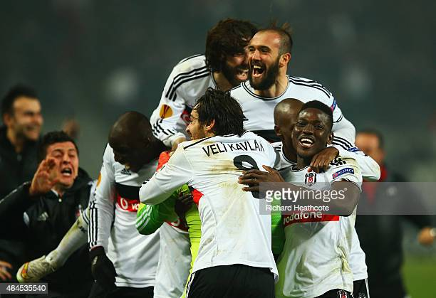 Besiktas players celebrate victory in the penalty shoot out as Dejan Lovren of Liverpool misses the decisive kick during the UEFA Europa League Round...