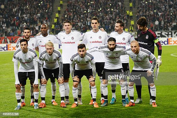 Besiktas' players pose for a team photo prior to the UEFA Europa League group H football match between Besiktas and Lokomotiv Moscow at the Ataturk...