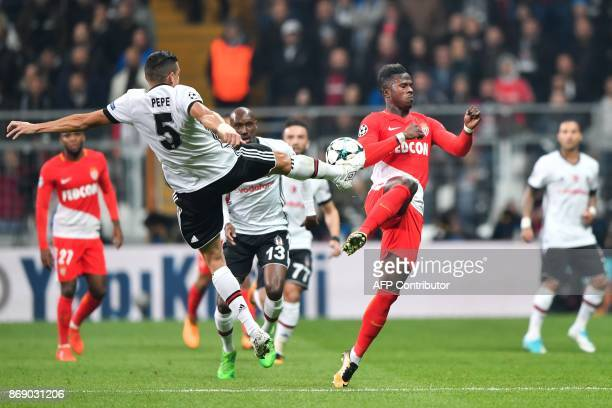 Besiktas' Portuguese defender Pepe shoots despite of Monaco's Senegalese forward Keita Balde during the UEFA Champions League Group G football match...