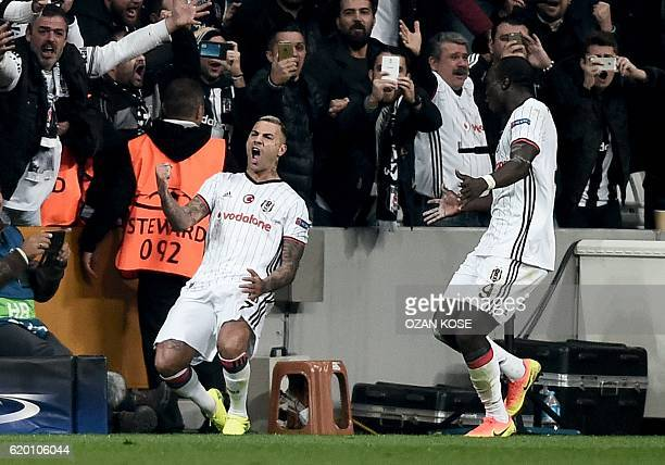Besiktas' Portuguese midfielder Ricardo Quaresma celebrates with teammate Cameroonian forward Vincent Aboubakar after scoring a goal against Napoli...