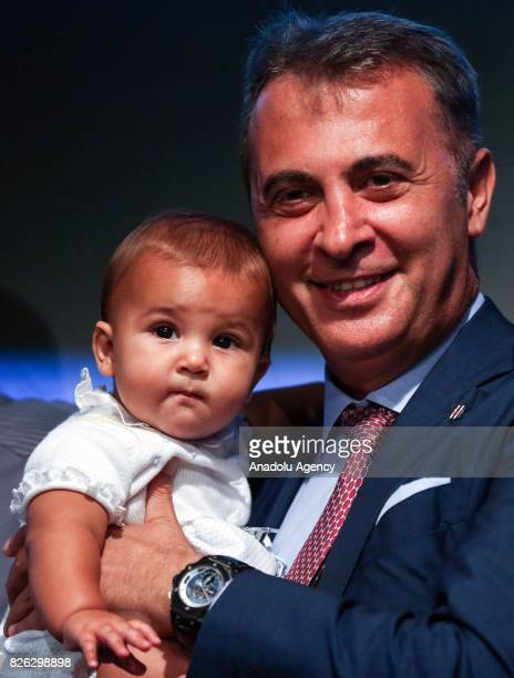 Besiktas' President Fikret Orman poses for a photo with Besiktas' new transfer Alvaro Negredo Sanchez's baby during a press conference after the...