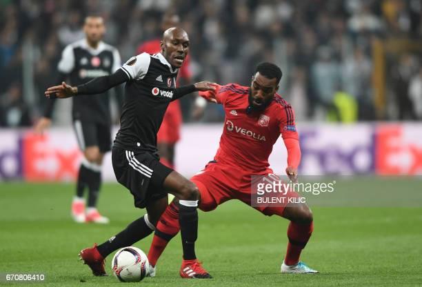 Besiktas' s Atiba Hutchinson vies with Lyon's Alexandre Lacazette during the UEFA Europa League second leg quarter final football match between...