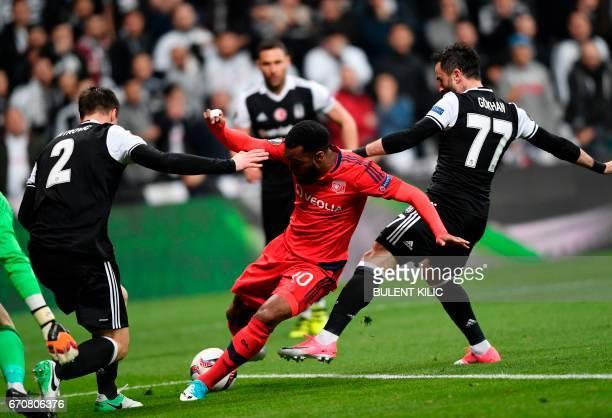 Besiktas' s Gokhan Gonul vies Lyon's Alexandre Lacazette during the UEFA Europa League second leg quarter final football match between Besiktas and...