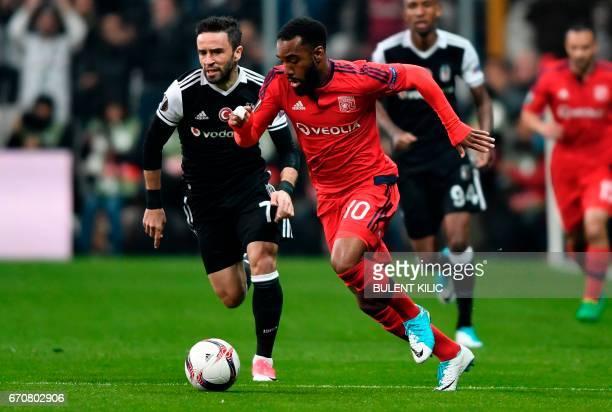 Besiktas' s Gokhan Gonul vies with Lyon's Alexandre Lacazette during the UEFA Europa League second leg quarter final football match between Besiktas...