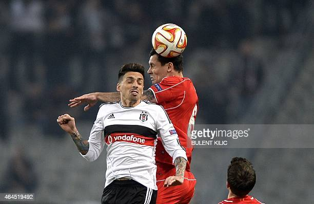 Besiktas' s Jose Sosa jumps for the ball with Liverpool's Dejan Kovren during the UEFA Europa League Round of 32 second leg football match between...