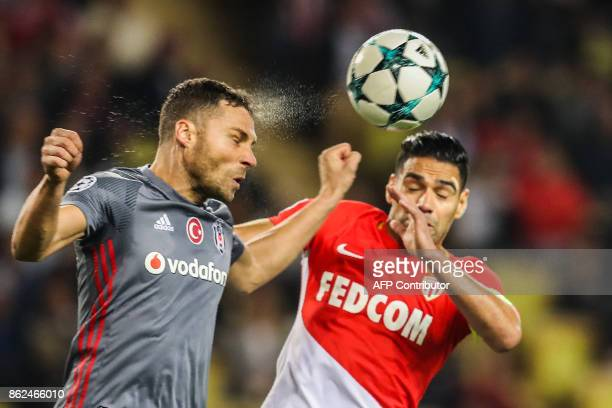 Besiktas' Serbian defender Dusko Tosic and Monaco's Colombian forward Radamel Falcao go for a header during the UEFA Champions League group stage...