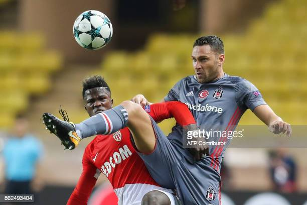 Besiktas' Serbian defender Dusko Tosic controls the ball ahead of Monaco's Senegalese forward Keita Balde during the UEFA Champions League group...