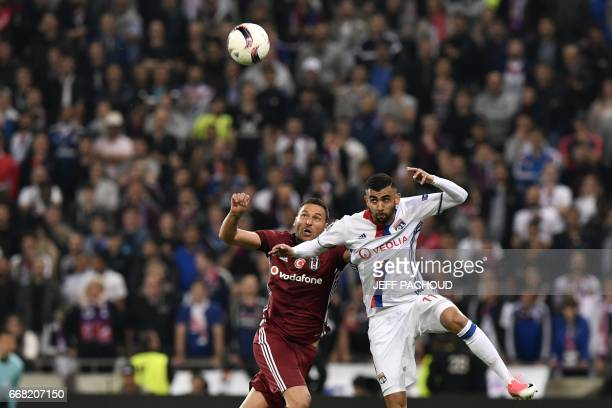 Besiktas' Serbian defender Dusko Tosic vies with Lyon's French Algerian midfielder Rachid Ghezzal during the UEFA Europa League first leg quarter...