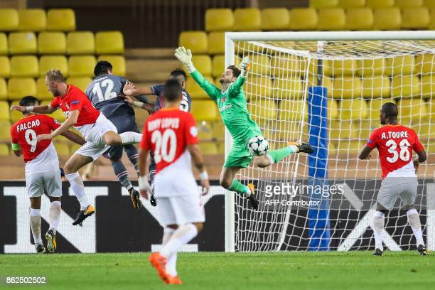 Besiktas' Spanish goalkeeper Fabricio Agosto Ramirez defends under pressure from Monaco's Colombian forward Radamel Falcao and Monaco's Polish...