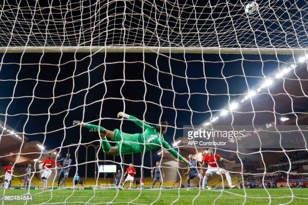 Besiktas' Spanish goalkeeper Fabricio Agosto Ramirez deflects a shot during the UEFA Champions League group stage football match between Monaco and...
