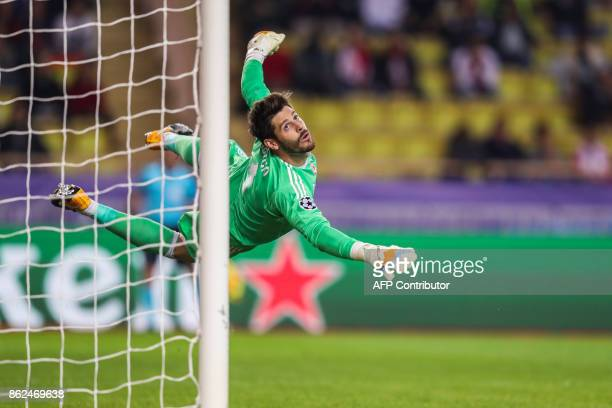 Besiktas' Spanish goalkeeper Fabricio Agosto Ramirez eyes the ball after making a save during the UEFA Champions League group stage football match...