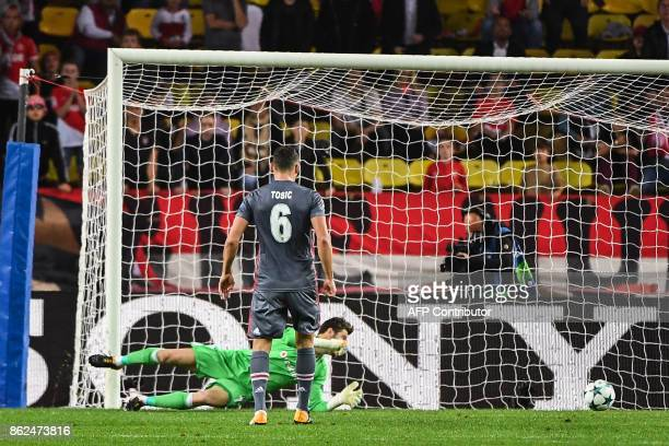 Besiktas' Spanish goalkeeper Fabricio Agosto Ramirez fails to stop the opening goal during the UEFA Champions League group stage football match...