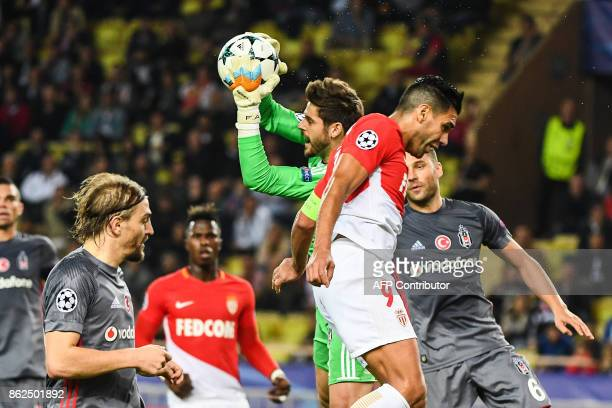 Besiktas' Spanish goalkeeper Fabricio Agosto Ramirez grabs the ball under pressure from Monaco's Colombian forward Radamel Falcao during the UEFA...