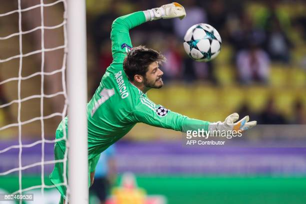 Besiktas' Spanish goalkeeper Fabricio Agosto Ramirez makes a save during the UEFA Champions League group stage football match between Monaco and...