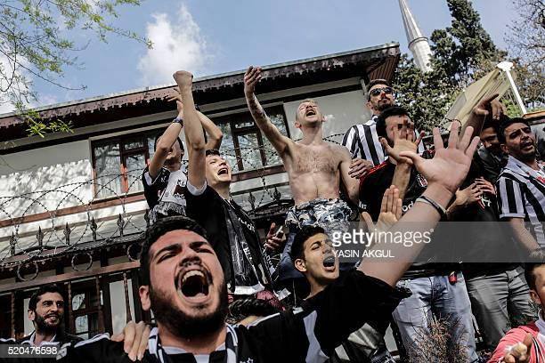 Besiktas supporters cheer their team before the Turkish Spor Toto Super league football match between Besiktas and Bursaspor at vodafone arena...