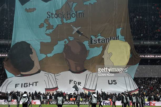 TOPSHOT Besiktas' supporters wave a giant banner referring to Stockholm the city that will host the final of the UEFA Europa League during the UEFA...