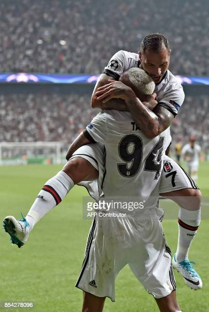 Besiktas` Talisca celebrates with teammate Ricardo Queresma after scoring during the UEFA Champions League group G football match between Besiktas...