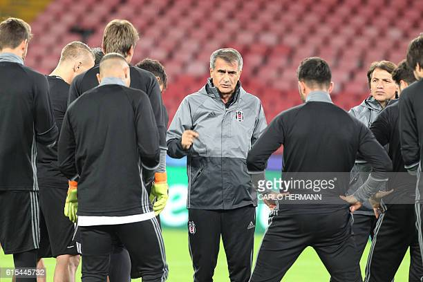 Besiktas' Turkish coach Senol Gunes gestures during a training session at the San Paolo Stadium in Naples on October 18 2016 on the eve of the UEFA...